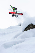 Eric Poulin pops a method off a pillow in Rogers Pass, BC
