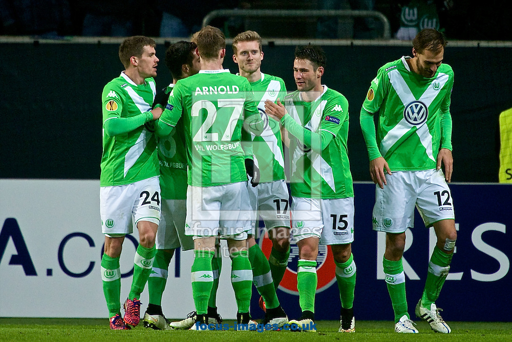 Bas Dost of VfL Wolfsburg (right) celebrates scoring their second goal to make it VfL Wolfsburg 2 Sporting Clube de Portugal 0 during the UEFA Europa League match at Volkswagen Arena, Wolfsburg<br /> Picture by Ian Wadkins/Focus Images Ltd +44 7877 568959<br /> 19/02/2015
