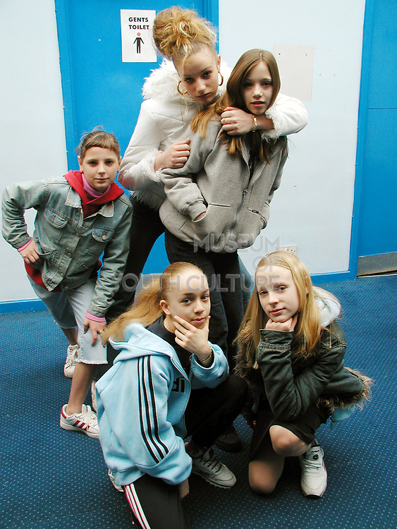 Group of young girl posing for the camera, London, UK, 2000's