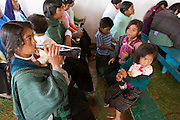 24 APRIL 2005 - SAN CRISTOBAL DE LAS CASAS, CHIAPAS, MEXICO:   Mayan Indians drink Coca Cola after mass in a small Catholic church in San Cristobal de las Casas, Chiapas. The Catholic church in Chiapas is under increasing pressure and facing competition from evangelical Protestant churches in Mexico. PHOTO BY JACK KURTZ