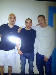 © Licensed to London News Pictures. 05/03/2012. Bolton, UK. Collect picture of Anthony Grainger (left) with his brother Stuart Grainger (centre). Anthony Grainger died as a result of a single gunshot wound to the chest, during a police operation in Culcheth, Cheshire, on the evening of Saturday 3rd March 2012. Three men have been charged with conspiracy to commit robbery. The IPCC are investigating the death. An inquest is due to take place at Warrington Coroners Court today (5th March). Photo credit : LNP