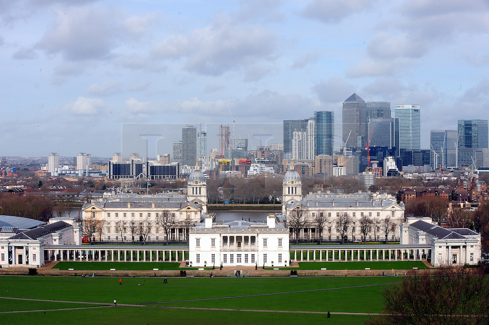 © Licensed to London News Pictures. 04/03/2017<br /> View of Canary Wharf and National Maritime Museum from Greenwich Park.<br />  A bright spring day at Greenwich Park,Greenwich,London.<br /> Photo credit :Grant Falvey/LNP