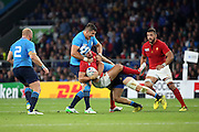 Alexandre Dumoulin (France's centre)  getting tackled and taken off his feet during the Rugby World Cup Pool D match between France and Italy at Twickenham, Richmond, United Kingdom on 19 September 2015. Photo by Matthew Redman.