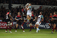 Dan Biggar  of the Ospreys &copy; jumps for a high ball with Lee Byrne of the Dragons. Guinness Pro12 rugby union, Newport Gwent Dragons v Ospreys at Rodney Parade in Newport, South Wales on Friday 12th Sept 2014<br /> pic by Andrew Orchard, Andrew Orchard sports photography.