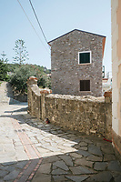 ACCIAROLI, ITALY - 14 SEPTEMBER 2018: A house in Acciaroli, a small fishing village in the municipality of Pollica, Italy, on September 14th 2018.<br /> <br /> To understand how people can live longer throughout the world, researchers at University of California, San Diego School of Medicine have teamed up with colleagues at University of Rome La Sapienza to study a group of 300 citizens, all over 100 years old, living in Acciaroli (Pollica), a remote Italian village nestled between the ocean and mountains in Cilento, southern Italy.<br /> <br /> About 1-in-60 of the area's inhabitants are older than 90, according to the researchers. Such a concentration rivals that of other so-called blue zones, like Sardinia and Okinawa, which have unusually large percentages of very old people. In the 2010 census, about 1-in-163 Americans were 90 or older.