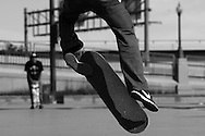 A skater at the Denver Skatepark flips his board into a 'treflip' or 360 flip on October 25, 2013.