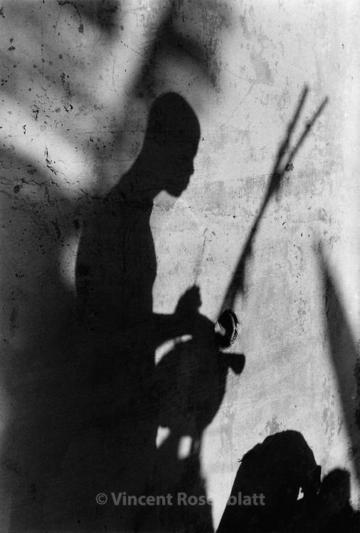 Traditional music instrument Berimbau, during a capoeira session in Morro do Fallet, Santa Teresa area, Rio de Janeiro. ||.Berimbau numa roda de Capoeira, Morro do Fallet, Santa Teresa, Rio de Janeiro.