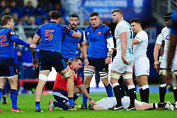 Yoann Maestri of France is held back by referee Nigel Owens as Dylan Hartley of England lies unconscious on the floor - Mandatory byline: Patrick Khachfe/JMP - 07966 386802 - 19/03/2016 - RUGBY UNION - Stade de France - Paris, France - France v England - RBS Six Nations.