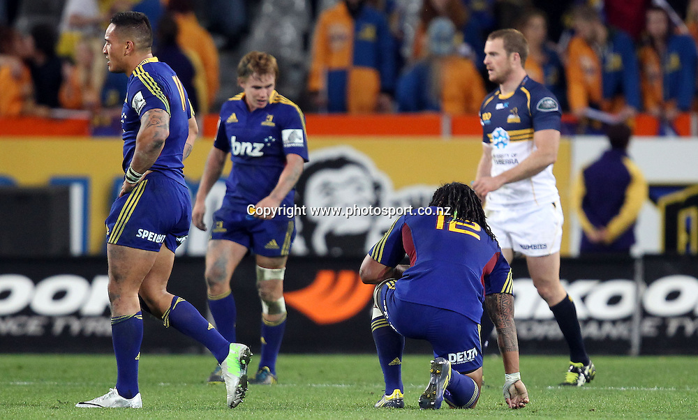 A dejected Ma'a Nonu, Hosea Gear and Hayden Parker of the Highlanders after their loss to the Brumbies.<br /> Super Rugby - Highlanders v Brumbies, 12 April 2013, Forsyth Barr Stadium, Dunedin, New Zealand.<br /> Photo: Rob Jefferies / photosport.co.nz