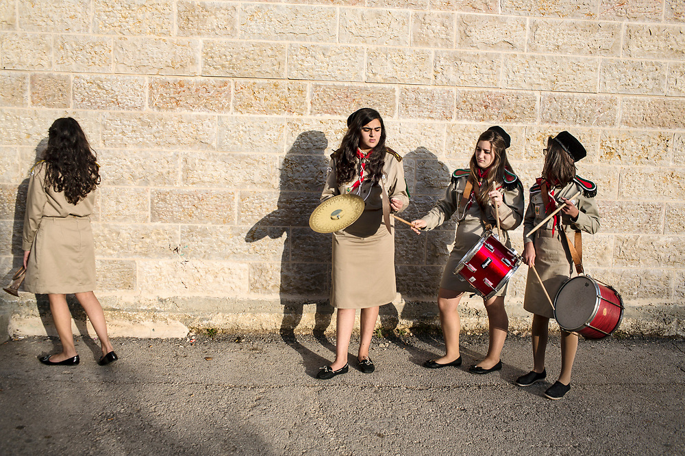 """The Palestinian Girl Scouts of Ramallah at band practice.<br /> <br /> Faiza (cymbols) and her family left Gaza after Israeli military incursions of last summer. Her family said 'enough'.  Founded in 1912, the scouts are a long respected Palestinian institution and their charter """"accepts all diversity of Palestinians, to promote values  in creating a better world."""" The girls joked they were on cusp of making their own rock and roll all girl band."""