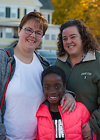 "Christina Liberatore, Julie DiBona and Phoebe DiBona-Liberatore  Laconia, NH.  Christina said ""I'm excited to see the country move in the direction of overall inclusiveness.""  Julie and Phoebe ""Ditto"".  Voted for Hillary Clinton.  (Karen Bobotas/for the Laconia Daily Sun)"