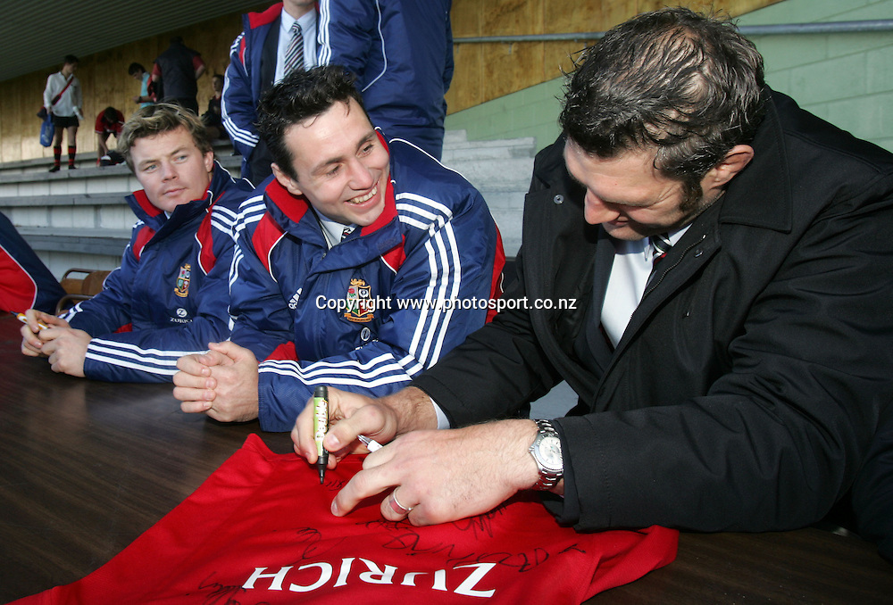 Simon Shaw signs autographs while Lions captain Brian O'Driscoll and Stephen Jones look on at Victoria Park, Stratford, New Plymouth, New Zealand on Wednesday 8 June, 2005. The Lions play Taranaki tonight. Photo: Hannah Johnston/PHOTOSPORT
