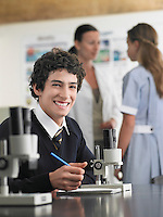 High school student sitting at desk in chemistry class portrait
