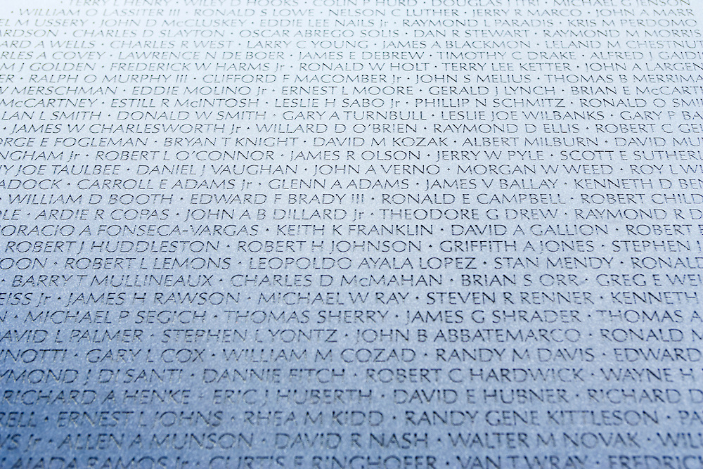 Names of those killed in the Vietnam war etched into the Vietnam War Memorial.  Washington, D.C.  USA