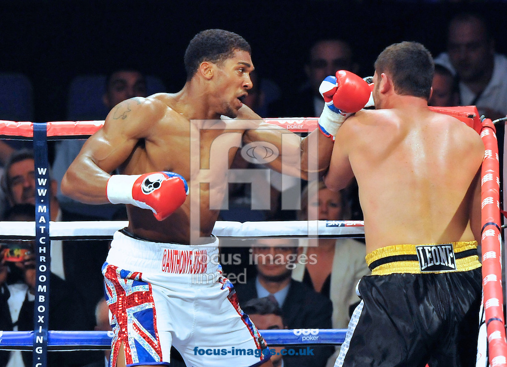 Picture by Alan Stanford/Focus Images Ltd +44 7915 056117<br />05/10/2013<br />Anthony Joshua and Emanuele Leo during their Heavyweight Contest at the O2 Arena, London.