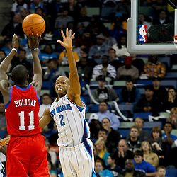 January 4, 2012; New Orleans, LA, USA; Philadelphia 76ers point guard Jrue Holiday (11) shoots over New Orleans Hornets point guard Jarrett Jack (2) during the second quarter of a game at the New Orleans Arena.   Mandatory Credit: Derick E. Hingle-US PRESSWIRE