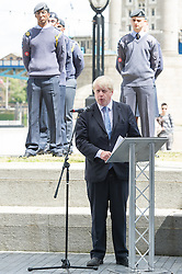 © London News Pictures. 22/06/15. London, UK. Boris Johnson stands with Air Force cadets behind him during a ceremony to honour UK Armed Forces, Central London. Photo credit: Laura Lean/LNP