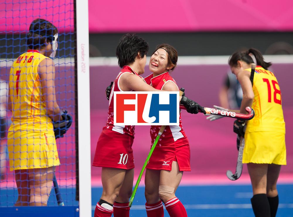 London Olympics 06/08/2012.Womens Hockey Japan v China.Rika Komazawa in congratulated by Miyuki Nakagawa of China..Photo: Grant Treeby