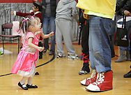 Middletown, New York - Two little girls wearing a costumes dance with Scrunchy, the ShopRite mascot, during the Family Fall Festival at the Middletown YMCA on Oct. 23, 2010.