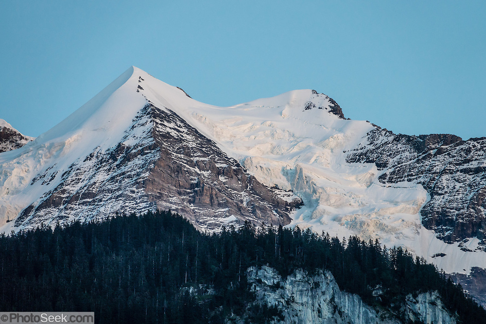 The Silberhorn (3695 m) is a snowy pyramid-shaped satellite peak of Jungfrau. Seen at sunset from Hotel Oberland, Lauterbrunnen, Switzerland, the Alps, Europe.