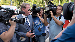 August 9, 2017 - Palm Beach Gardens, Florida, U.S. - Tiger Woods' attorney, Douglas Duncan, enters the north Palm Beach County courthouse Wednesday morning, August 9, 2017. Duncan is representing Woods in his DUI case. (Credit Image: © Allen Eyestone/The Palm Beach Post via ZUMA Wire)