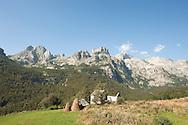 Haystacks near the village of Çeremi, with Maja Kolata (Kolata e Keq, 2534m) in the background, viewed from the trail to Dobërdol, Peaks of the Balkans trail, Albania © Rudolf Abraham