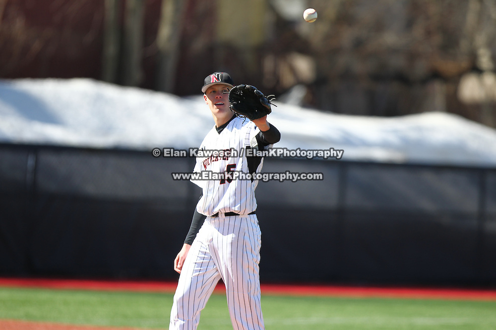 Dustin Hunt #45 of the Northeastern Huskies catches the ball during the game at Friedman Diamond on March 16, 2014 in Brookline, Massachusetts. (Photo by Elan Kawesch)