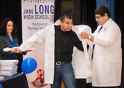 Freshman Pharmacy Technology sudents at Jane Long Academy received their white coats in a ceremony, March 7, 2014.