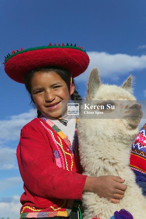 Indian girl with alpaca, Cuzco, Peru