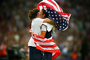 USA's Abby Wambach (R) and Lauren Cheney (L) celebrates victory in the Women's Football gold medal match