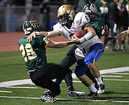 Wahlert's Riley McCarron (6) bounces off Kennedy's Alexander Hillyer (28) on a run during the first half of the game between Cedar Rapids Kennedy and Dubuque Wahlert at Kingston Stadium in Cedar Rapids on Friday night, October 21, 2011.