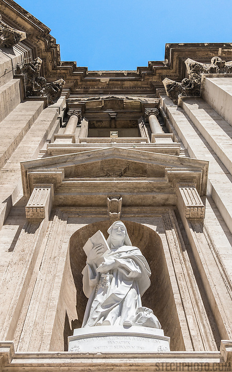 Architectural details and a statue on the exterior of St. Peter's Basilica in Vatican City.
