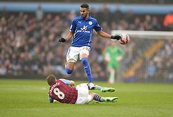 Aston Villas Tom Cleverley tackles Leicester City's Andy King - Photo mandatory by-line: Alex James/JMP - Mobile: 07966 386802 - 15/02/2015 - SPORT - Football - Birmingham - Villa Park - Aston Villa v Leicester City - FA Cup - Fifth Round