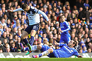 Frank Lampard of Chelsea tackels Kevin Mirallas of Everton during the Barclays Premier League match at Stamford Bridge, London<br /> Picture by David Horn/Focus Images Ltd +44 7545 970036<br /> 22/02/2014