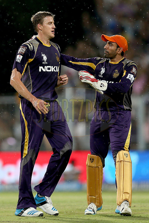 Morne Morkel and Robin Uthappa celebrate a wicket during the first qualifier match (QF1) of the Pepsi Indian Premier League Season VII 2014 between the Kings XI Punjab and the Kolkata Knight Riders held at Eden Gardens Cricket Stadium, Kolkata, India on the 28th May 2014. Photo by Jacques Rossouw / IPL / SPORTZPICS<br /> <br /> <br /> <br /> Image use subject to terms and conditions which can be found here:  http://sportzpics.photoshelter.com/gallery/Pepsi-IPL-Image-terms-and-conditions/G00004VW1IVJ.gB0/C0000TScjhBM6ikg