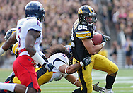 September 19, 2009: Iowa wide receiver Colin Sandeman (22) tries to run out of a tackle by Arizona linebacker Vuna Tuihalamaka during the Iowa Hawkeyes' 27-17 win over the Arizona Wildcats at Kinnick Stadium in Iowa City, Iowa on September 19, 2009.