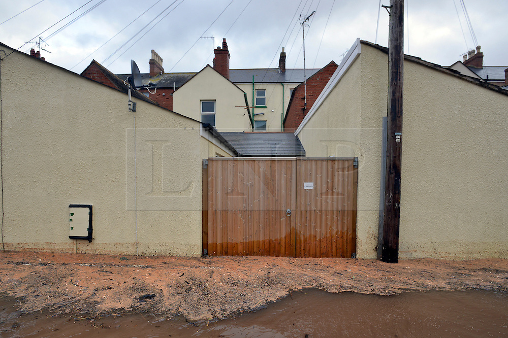 © Licensed to London News Pictures. 03/02/2014. Exmouth, UK Seawater floods the seafront in Exmouth Devon.The water breached defences and flooded Morton Road, St Andrews Roads, Victoria Road and some of the other surrounding streets. Police closed the road to vehicles. Officials were seen delivering sandbags to the local residents. . Photo credit : Russ Nolan/LNP