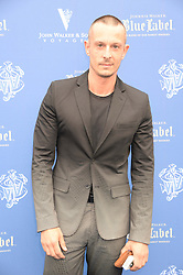 The Johnnie Walker Blue Label and David Gandy Drinks Reception aboard John Walker & Sons Voyager, St.Georges Stairs Tier, Butler's Wharf Pier, London, UK on 16th July 2013.<br /> Picture Shows:-Jonathan Saunders.