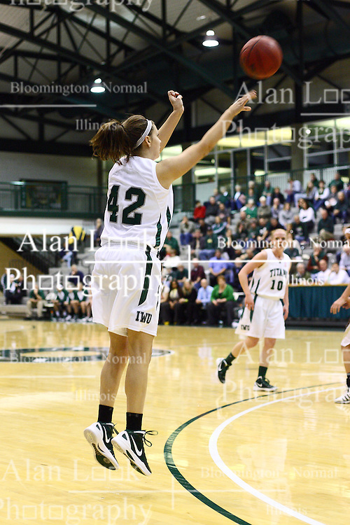 17 December 2011:  Annie Brown steps into a three point shot with no defender during an NCAA womens division 3 basketball game between the St. Francis Fighting Saints and the Illinois Wesleyan Titans in Shirk Center, Bloomington IL