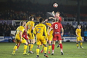 Terry Kennedy of Alfreton Town wins the header during the The FA Cup match between Newport County and Alfreton Town at Rodney Parade, Newport, Wales on 15 November 2016. Photo by Andrew Lewis.