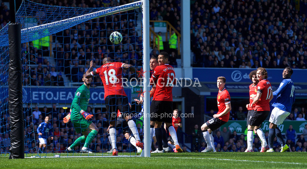 LIVERPOOL, ENGLAND - Sunday, April 26, 2015: Manchester United's Ashley Young cannot prevent Everton's John Stones [hidden] from scoring the second goal during the Premier League match at Goodison Park. (Pic by David Rawcliffe/Propaganda)