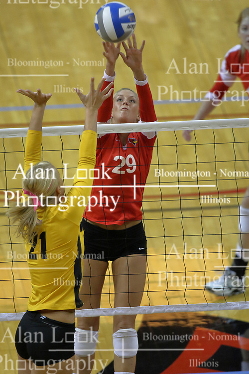 23 October 2010: Mallory Leggett tips the ball at the net in the direction of blocker Sarah McGee during an NCAA, Missouri Valley Conference volleyball match between the Wichita State Shockers and the Illinois State Redbirds at Redbird Arena in Normal Illinois.