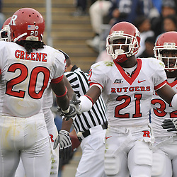 Oct 31, 2009; East Hartford, CT, USA; Rutgers cornerbacks Devin Mccourty (21) and Khaseem Greene (20) high five after McCourty downed a punt on Connecticut's 1-yard line during second half Big East NCAA football action in Rutgers' 28-24 victory over Connecticut at Rentschler Field.