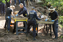 July 5, 2018 - Toronto, ON, Canada - TORONTO, ON - JULY 5  -  Investigators sift through compost looking for human remains in the back area of 53 Mallory Crescent in Toronto, July 5, 2018. The property is linked to the Bruce McArthur murder investigation. Andrew Francis Wallace/Toronto Star (Credit Image: © Andrew Francis Wallace/The Toronto Star via ZUMA Wire)