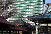 new high rise with in the foreground low rise residential housing and a traditional old Japanese temple complex Yokosuka Japan