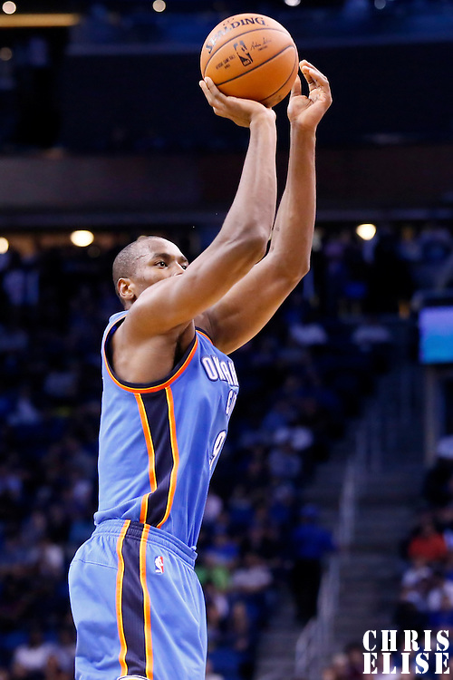 30 October 2015: Oklahoma City Thunder forward Serge Ibaka (9) takes a jump shot during the Oklahoma City Thunder 139-136 double overtime victory over the Orlando Magic, at the Amway Center, in Orlando, Florida, USA.
