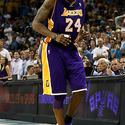 April 24, 2011; New Orleans, LA, USA; Los Angeles Lakers shooting guard Kobe Bryant (24) tries to walk off an injured ankle during the fourth quarter in game four of the first round of the 2011 NBA playoffs against the New Orleans Hornets at the New Orleans Arena. The Hornets defeated the Lakers 93-88.   Mandatory Credit: Derick E. Hingle