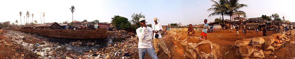 Double K, Kool King (front) and King Osu (back) by the Crocodile River in Kroo Bay, Freetown, Sierra Leone.