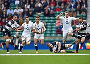England centre Henry Slade (Exeter Chiefs)breaks past Barbarians lock Brad Thorn (Leicester & New Zealand) with England flanker Mark Wilson (Newcastle Falcons) and England lock Joe Launchbury (Wasps)in support during the International Rugby Union match England XV -V- Barbarians at Twickenham Stadium, London, Greater London, England on May  31  2015. (Steve Flynn/Image of Sport)