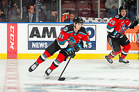 KELOWNA, BC - NOVEMBER 1: Pavel Novak #11 of the Kelowna Rockets skates with the puck against the Prince George Cougars  at Prospera Place on November 1, 2019 in Kelowna, Canada. (Photo by Marissa Baecker/Shoot the Breeze)